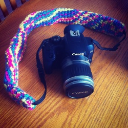 Mom crocheted me a sleeve for my camera strap.