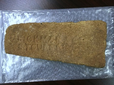 The maker's mark suggests that it was made between 1865 and 1929 by a firebrick making company from Stourbridge, England. Curiously discovered by Carol Brice-Bennett near a building after being used to hold down a tent wall.