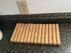 Crafting... corks glued to board to make a hot plate